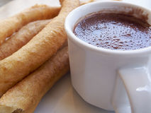 Churros Con Chocolate. Is a popular Spanish dessert of fried sticks dipped in hot chocolate Stock Images