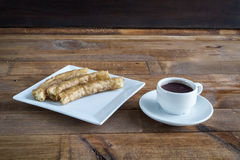 Churros con chocolate, a typical Spanish sweet snack Royalty Free Stock Photography