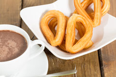 Churros con cioccolato Fotografia Stock