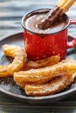 Churros con el chocolate caliente Foto de archivo libre de regalías