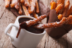 Churros with a cup of hot chocolate on a table. Horizontal Royalty Free Stock Images