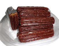 Churros die in chocolade wordt ondergedompeld royalty-vrije stock afbeelding