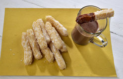 Churros e cioccolata 库存图片