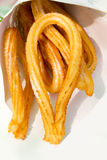 Churros fried crullers spanish flour fritters Stock Images