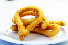 Churros gastronomic scene highlighting breakfast. Appetizing color and texture Stock Photos