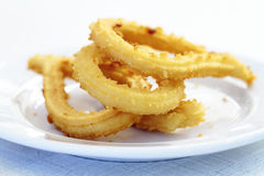 Churros gastronomic scene highlighting breakfast. Appetizing color and texture Royalty Free Stock Images