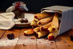 Churros. Hand made artisan mexican churros filled with creative flavors in a styled product shoot Stock Photos