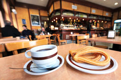 Churros and hot chocolate Stock Images
