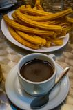 Churros and hot chocolate as served in a coffee shop in Madrid Royalty Free Stock Images