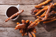 Churros and hot chocolate close-up on the table. horizontal top Stock Images