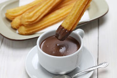 Churros and hot chocolate, spanish breakfast. Churros served with thick hot chocolate Royalty Free Stock Photos