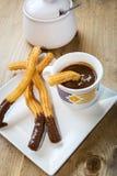 Churros with hot chocolate and sugar Stock Photo