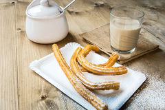 Churros with hot chocolate and sugar Stock Image