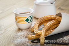Churros with hot chocolate and sugar Stock Photography