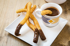 Churros with hot chocolate and sugar Royalty Free Stock Images