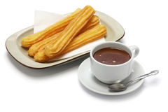 Churros and hot chocolate on white background Royalty Free Stock Images