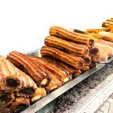 Churros on a market stall in a bakery shop. Sweet Famous Spanish royalty free stock image