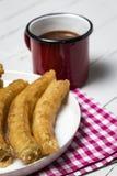 Churros med varm choklad Royaltyfria Bilder