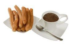 Churros mit Schokolade Lizenzfreie Stockfotos