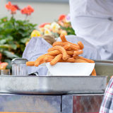 Churros on plate at food stall Royalty Free Stock Images
