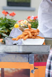 Churros on plate at food stall Stock Image