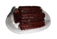 Churros sumergió en chocolate Imágenes de archivo libres de regalías