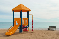 Chute. Colorful plastic chute on a beach playground Royalty Free Stock Photo