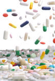 Chute colorée de pilules de médecine Images libres de droits