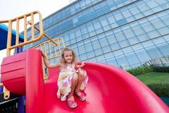 Chute. Happy girl sliding on chute Royalty Free Stock Image