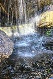 Chutes dans la grotte en pierre Photographie stock libre de droits