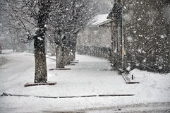 Chutes de neige de l'hiver dans la ville Image libre de droits