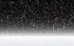 Chutes de neige sur un ciel nocturne Image libre de droits