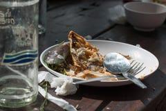 Chutes de nourriture sur la table Photographie stock libre de droits
