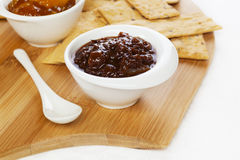 Chutney and Crackers. Little bowls of chutney and crisp crackers Stock Photo