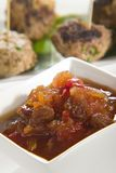 Chutney with meatballs in background Royalty Free Stock Images