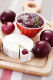 Chutney plum with cheese Royalty Free Stock Photography