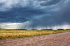 Chuva acima da estrada no estepe de Cazaquistão Fotografia de Stock Royalty Free