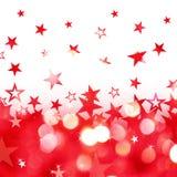 A chuva brilhante do vermelho stars o fundo Fotos de Stock