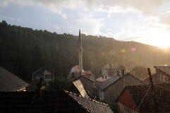 Chuva de mola com por do sol fotografia de stock