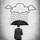 Chuva do homem de negócios e do desenho Foto de Stock