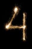 Chuveirinho número quatro da fonte do ano novo no fundo preto Imagens de Stock Royalty Free