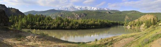 Chuya River and snow capped North Chuysky ridge Royalty Free Stock Photography