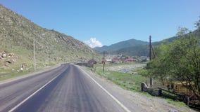 Chuysky Trakt near the village Kupchegen. Altai Republic, Russia - July 14, 2015: Chuysky Trakt near the village Kupchegen stock footage