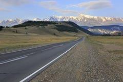 Chuysky Trakt and snow caps of North Chuya ridge Royalty Free Stock Images