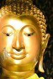 Ciérrese encima de Buda hacen frente a color oro imagenes de archivo