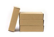 Ciérrese encima de cuatro cajas marrones Imagen de archivo libre de regalías