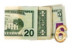 Ciérrese encima de escrito 2016 con los dólares aislados en blanco Fotografía de archivo libre de regalías