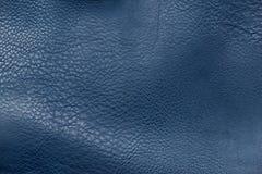 Ciérrese encima de fondo de cuero azul de la textura Fotos de archivo libres de regalías