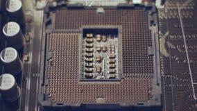ciérrese encima de fondo de la tecnología Microprocesador de circuito electrónico en el zócalo de la PC metrajes