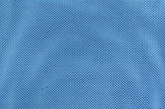 Ciérrese encima de fondo de la textura del tejido de poliester azul Imagen de archivo
